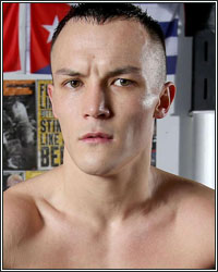 JOSH WARRINGTON VACATES IBF TITLE; TARGETS GARY RUSSELL JR. AND XU CAN